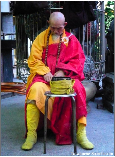begging monk outside a temple in taiwan