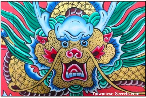 painting of a colorful chinese dragon in a temple