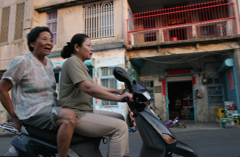 taiwanese women riding a scooter
